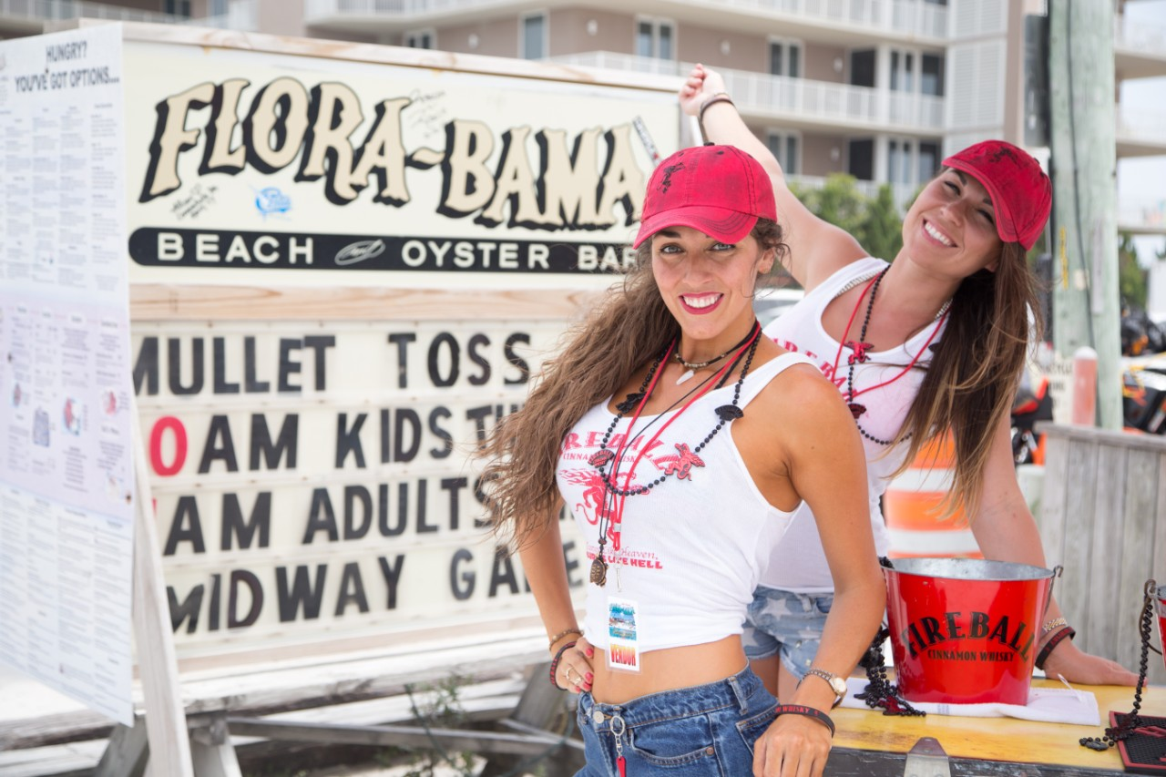 Two female Fireball ambassadors in front of Flora-Bama bar